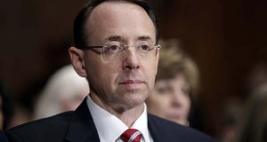 FILE- In this March 7, 2017, file photo, then-Deputy Attorney General-designate Rod Rosenstein, listens on Capitol Hill in Washington, during his confirmation hearing before the Senate Judiciary Committee. (AP Photo/J. Scott Applewhite, File)