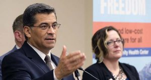 California Attorney General Xavier Becerra answers questions during a news conference at St. John's Well Child and Family Center in Los Angeles on Thursday May 18, 2017. Democrats in California, New York and other states are trying to intervene in a federal lawsuit that threatens to undercut funding for the Affordable Care Act. Becerra said that the states want to step into the case in federal court in Washington to protect care for millions of Americans. (AP Photo/Richard Vogel)
