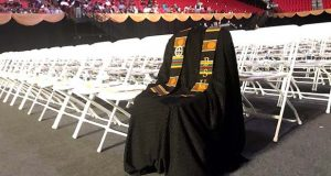 In the photo provided by Neal Augenstein, WTOP, Richard Collins III's graduation gown draped over front row chairs at Bowie State University ceremony, Tuesday, May 23, 2017, in College Park, Md.   (Neal Augenstein/WTOP via AP)