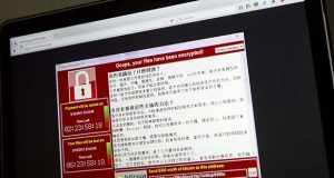 FILE - In this May 13, 2017, file photo, a screenshot of the warning screen from a purported ransomware attack, as captured by a computer user in Taiwan, is seen on a laptop in Beijing. As danger from the global cyberattack continues to fade, analysts are starting to assess the damage. The good news: Hard-hit organizations such as the U.K.'s National Health Service appear to be bouncing back, and few people seem to have actually paid the ransom. The bad: This attack has demonstrated how a new automated form of malware can spread rapidly, potentially encouraging future hackers. (AP Photo/Mark Schiefelbein, File)