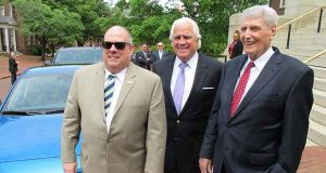 Maryland Gov. Larry Hogan, left, stands with Senate President Thomas V. Mike Miller and House Speaker Michael Busch, right, in front of an electric car by the Maryland State House on Thursday, May 4, 2017 in Annapolis, Md., before riding in the car to a waterside bill signing ceremony on environmental legislation approved this year. (AP Photo/Brian Witte)