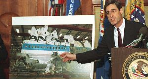 FILE - In this Nov. 14, 1991, file photo, then-Assistant Attorney General Robert Mueller points to a photo of the reconstructed wreckage of Pan Am Flight 103, which exploded over Lockerbie Scotland in 1988, killing 270 people. Mueller once again finds himself catapulted into the midst of historic events: The Justice Department has named him special counsel to investigate potential coordination between Russia and the Donald Trump team during the 2016 presidential election and related matters. (AP Photo/Barry Thumma, File)