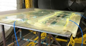 SolarWindow Technologies announced that its transparent electricity-generating glass has been successfully processed through an autoclave system for window glass lamination at a commercial window fabricator. (SolarWindow photo)