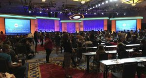 The 291 elementary- and middle-schoolers competing in the 90th Scripps National Spelling Bee gather at a convention center in Oxon Hill, Md., Tuesday, may 30, 2017, to take the bee's nerve-wracking written test. The test goes a long way toward determining who will be among the 50 or so spellers to advance beyond the preliminary rounds.  (AP Photo/Ben Nuckols)