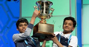 FILE - In this May 26, 2016, file photo, Nihar Janga, 11, of Austin, Texas, and Jairam Hathwar, 13, of Painted Post, N.Y., hold up the trophy after being named co-champions at the 2016 National Spelling Bee, in Oxon Hill, Md. To the fans watching on ESPN, Janga's win last year in the Scripps National Spelling Bee was a shock: He was only 11 years old, a fifth-grader appearing in the bee for the first time, competing against 8th-graders with deep voices and facial hair. (AP Photo/Jacquelyn Martin, File)