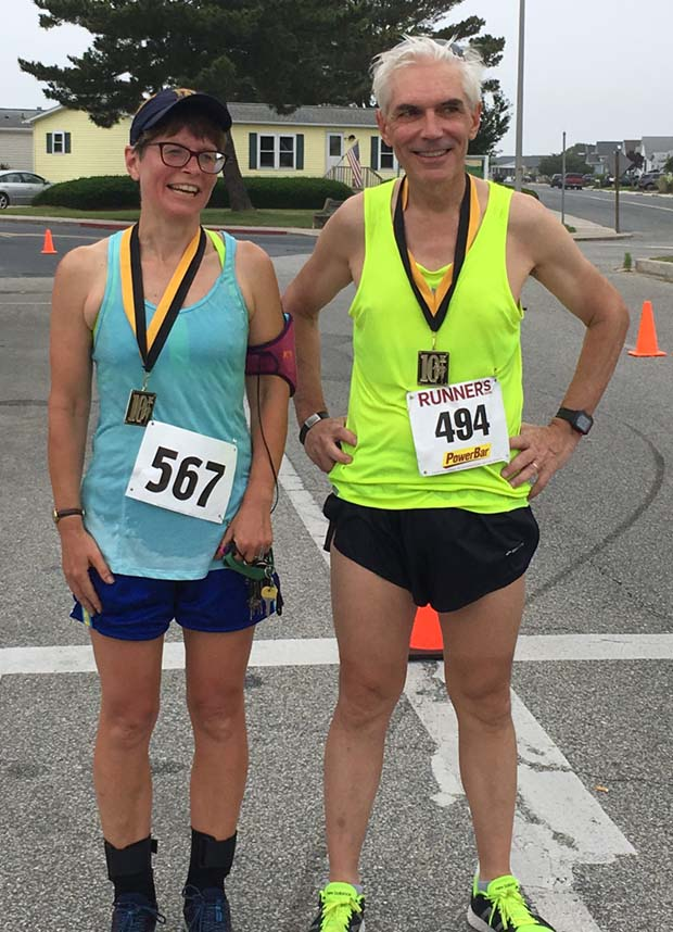 The winners of the women's and men's 10K: Amy Malone, an associate at the Law Office of Michael Malone in Gambrills, and Court of Special Appeals Judge Kevin F. Arthur. (The Daily Record / Darice Dixon)