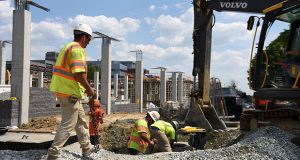 06.12.17 BALTIMORE, MD- Construction workers are busy erecting the the 33-acre, $460 Million, 260 apartment based mixed use development at the intersection of West Fayette and N. Schroeder Street near the University of Maryland Bio Park and the historic Poe House.  (Maximilian Franz/The Daily Record)