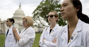 Physicians and health workers join House Democrats to speak out on the impact of the Republican health care plan, on Capitol Hill in Washington, Thursday, June 22, 2017. (AP Photo/Andrew Harnik)
