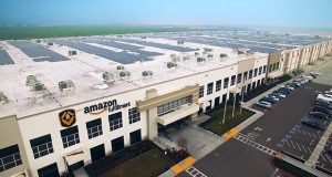 An Amazon fulfillment center has an array of solar panels on its roof. (Submitted Photo)