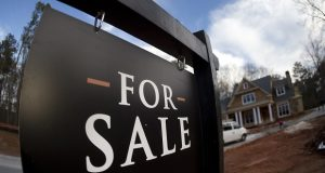 FILE - In this Thursday, Dec. 3, 2015, file photo, a home under construction and for sale is shown in Roswell, Ga. On Tuesday, July 26, 2016, the Commerce Department reports on sales of new homes in June. (AP Photo/John Bazemore, File)