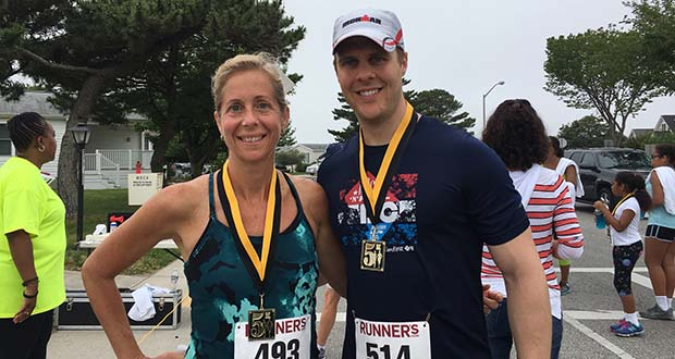 The winners of the women's and men's 5K: D. Jill Green, an assistant dean at the University of Baltimore, and Zachary Reichenbach of Baltimore accounting firm Ellin & Tucker. (The Daily Record / Darice Dixon)