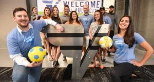 7.5.17 BALTIMORE, MD- Front left and Right- Giovanni Marcontoni, CEO of Volo City and Nayla Bautista, Excutive Director of Volo City Kids Foundation, posing with their new logo with their work team behind them.  (Maximilian Franz/The Daily Record)