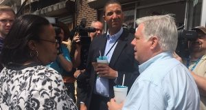 Keiffer Mitchell (center) enjoying a skylite snowball with Gov. Larry Hogan during a 2015 tour of Pennsylvania Avenue following the riots after the death of Freddie Gray. (The Daily Record / Bryan P. Sears)