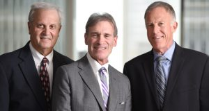'One of the reasons we're able to grow is that we have been a risk-taking firm in a risk-averse marketplace,' says Ted Offit, right, of Offit Kurman. Ted Offit, Maurice Offit, left, and Howard Kurman, center, formed their firm 30 years ago. (Maximilian Franz/The Daily Record)