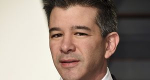 """FILE - In this Sunday, Feb. 26, 2017, file photo, Uber CEO Travis Kalanick arrives at the Vanity Fair Oscar Party in Beverly Hills, Calif. Kalanick resigned under pressure from investors at a pivotal time for Uber. Uber's board confirmed the move early Wednesday, June 21, saying in a statement that Kalanick is taking time to heal from the death of his mother in a boating accident """"while giving the company room to fully embrace this new chapter in Uber's history."""" (Photo by Evan Agostini/Invision/AP, File)"""