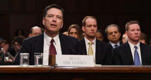 """Former FBI Director James Comey appears before the Senate Intelligence Committee.Comey blasted the Trump administration for bad-mouthing the bureau and his leadership to justify his firing, saying """"those were lies, plain and simple.'' MUST CREDIT: Matt McClain, The Washington Post."""