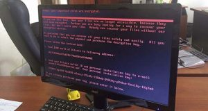 A computer screen cyberattack warning notice reportedly holding computer files to ransom, as part of a massive international cyberattack, at an office in Kiev, Ukraine, Tuesday June 27, 2017,   A new and highly virulent outbreak of malicious data-scrambling software appears to be causing mass disruption across Europe, hitting Ukraine especially hard.  Image used with permission of the account holder facebook.com/olejmaa checked and consistent with independent AP reporting.  (Oleg Reshetnyak via AP)
