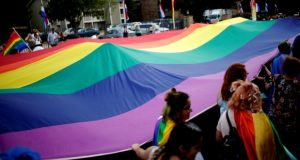 People march with a rainbow flag during the Oklahoma City Pride Parade on Sunday, June 25, 2017, in Oklahoma City. (Sarah Phipps/The Oklahoman via AP)