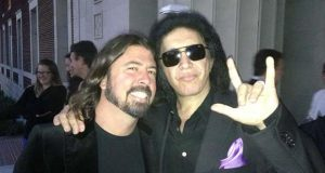 "Musician Dave Grohl, left, stands with Gene Simmons in this undated photo attached as a specimen to Simmons' application to trademark the gesture he is making in the photo. It is described in the application as ""	a picture of applicant showing use of the mark in connection with the services.""  (U.S. Patent and Trademark Office)"