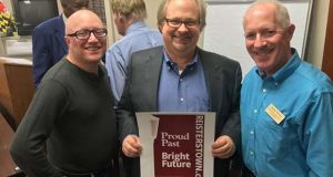 No Other Name Studios' design was chosen as the winner in the Reisterstown Improvement Association's banner contest. Irwin Kramer, chairman of the asociation, left, stands with Thomas Henry, owner of No Other Name Studios, center, and Herb Weiss, president of the association. (submitted photo)