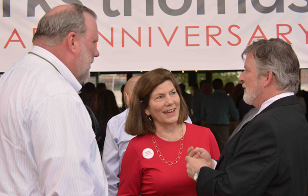 From left, Sean Davis, a principal in land development and planning with Morris & Ritchie Associates; Priscilla Carroll, a partner with Bowie & Jensen; and Tom Liebel, a principal with Marks Thomas, enjoy a conversation during Marks Thomas' 50th anniversary celebration.