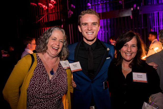 From left, Amy Wilson, director of Learning Communities with Teach for America – Baltimore; Wyatt Oroke, a teacher with the National Academy Foundation School; and Sonya Kannam, a librarian at Hamstead Hill Elementary, were all smiles at the second annual Heart of the School Awards. (Photo courtesy of The Fund For Educational Excellence)
