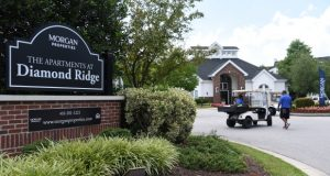 A sign outside the leasing office for The Apartments at Diamond Ridge displays new owner Morgan Properties' name. (Maximilian Franz/The Daily Record)