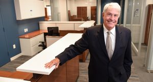 Bill Carrier, Managing Partner at Tydings and Rosenberg, gives a tour on Friday of their new office space at 1 East Pratt Street in Baltimore. (The Daily Record/Maximilian Franz)