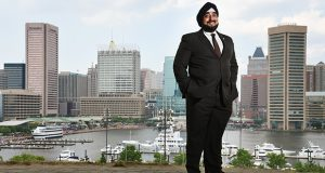 """""""I got tired of driving by these benches that say 'Baltimore, America's Greatest City' and … when I see the people sitting on them they don't look like they're doing so great,"""" says businessman and investor Kahan S. Dhillon Jr. (The Daily Record / Maximilian Franz)"""