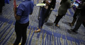 Job seekers wait to speak with recruiters during a Job News USA career fair in Overland Park, Kansas, on March 8, 2017. Bloomberg photo by Luke Sharrett.