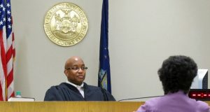 In this June 20, 2017 photo, City Court Judge Craig Hannah presides at Opiate Crisis Intervention Court in Buffalo, N.Y. The first such program in the country puts users under faster, stricter supervision than ordinary drug courts, all with the goal of keeping them alive.  (Carolyn Thompson/AP Photo)