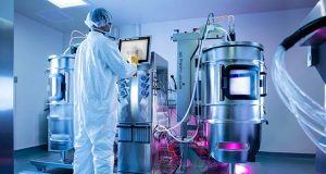 An Advanced BioScience Laboratories scientist monitors a  manufacturing run in the company's single-use bioreactor in Rockville.  (Advanced BioScience Laboratories Inc. photo)