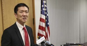 FILE - In this March 9, 2017, file photo, Hawaii Attorney General Douglas Chin speaks at a news conference in Honolulu. The top legal officers in 18 states and the District of Columbia have asked Congress to pass legislation prohibiting discrimination against transgender service members with Chin sending the letter dated Thursday, July 27, 2017, in response to President Donald Trump's announcement, via Twitter a day earlier, that he would ban transgender people in the military. (AP Photo/Marco Garcia, File)