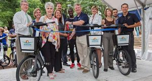 Howard County launched a bicycle sharing program in Columbia. Pictured are, from left: Steven C. Snelgrove, President, Howard County General Hospital; Danielle McQuigg, nursing director from Howard County General Hospital; Mary Kay Sigaty, Howard County Councilmember; Nikki Highsmith Vernick, President and CEO of the Horizon Foundation; Greg Fitchitt, Senior Vice President for Development, The Howard Hughes Corporation; Loomis Zayzay, Howard Community College student; Allan H. Kittleman, Howard County Executive; Barbara Nicklas, Senior General Manager, The Mall in Columbia; Jane Dembner, Director of Planning and Community Affairs, Columbia Association; Braunyno Belo Ayotte, Bewegen Technologies; Chris Eatough, Howard County Office of Transportation, Pedestrian and Bicycle Coordinator
