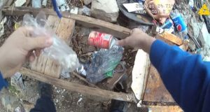 This still from body camera footage captured by Officer Richard Pinheiro in January shows him holding a bag with drugs he found inside a can in a vacant Baltimore lot - a can Pinheiro himself apparently planted based on body camera footage seconds earlier.