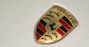 In this March 15, 2013 file photo the company logo of German car manufacturer Porsche is pictured prior to the annual news conference in Stuttgart, Germany. German prosecutors say they've opened an investigation into employees of Porsche, which is a unit of Volkswagen AG, and an American subsidiary over the possible manipulation of diesel emissions. Stuttgart prosecutors said Monday, July 13, 2017 they are investigating suspicions of fraud and making false claims. (AP Photo/Matthias Schrader, file)