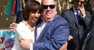 Baltimore Mayor Catherine Pugh and Gov. Larry Hogan hug after a news conference Thursday. (Maximilian Franz)