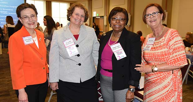 From left, Theresa Wiseman, MediaWise, Inc.; Pat Lambert, Pessin Katz Law, PA; Margaret Hayes, UM School of Pharmacy;  and Angie Barnett, BBB Serving Greater Maryland, at The Daily Record's Women's Leadership Summit. (The Daily Record / Maximilian Franz)