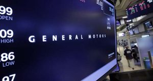 The General Motors logo appears above a trading post above the floor of the New York Stock Exchange, Monday, July 24, 2017. (AP Photo/Richard Drew)