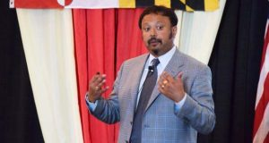 Anirban Basu speaks Friday at the Maryland Association of Counties annual meeting in Ocean City. (The Daily Record / Bryan P. Sears)