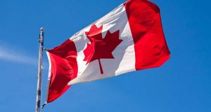 A Canada flag flapping in the wind (RachelD32 / Depositphotos.com)