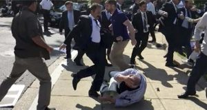 FILE- In this file frame grab from video provided by Voice of America, members of Turkish President Recep Tayyip Erdogan's security detail are shown violently reacting to peaceful protesters during Erdogan's trip last month to Washington. A grand jury in the U.S. capital announced Tuesday, Aug. 29, 2017, that it issued indictments for 19 people, including 15 identified as Turkish security officials, for attacking protesters in May 2017. (Voice of America via AP, File)