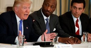 """In this Thursday, Feb. 23, 2017, file photo, President Donald Trump, left, speaks during a meeting with manufacturing executives at the White House in Washington, including Merck CEO Kenneth Frazier, center, and Ford CEO Mark Fields. Frazier resigned from the President's American Manufacturing Council citing """"a responsibility to take a stand against intolerance and extremism."""" Frazier's resignation comes shortly after a violent confrontation between white supremacists and protesters in Charlottesville, Va. (AP Photo/Evan Vucci, File)"""