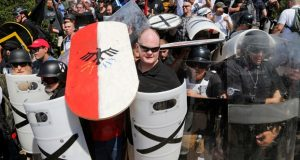 White nationalist demonstrators use shields as they guard the entrance to Lee Park in Charlottesville on Aug. 12. The American Civil Liberties Union is reeling from criticism for its role in defending the right of white supremacists' right to march in the Virginia city. After that rally left a counter protester dead, some critics said the ACLU had blood on its hands. (Steve Helber/AP file photo)