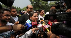 Farha Faiz, a Supreme Court lawyer, speaks to media after the top court declared 'triple talaq,' a Muslim practice that allows men to instantly divorce their wives, unconstitutional in its verdict, in New Delhi, India, Tuesday, Aug. 22, 2017. The court also requested the government legislate an end to the practice. (AP Photo/Altaf Qadri)