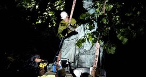 Workers remove a monument dedicated to U.S. Supreme Court Chief Justice Roger Brooke Taney from outside the Maryland State House, in Annapolis, Md., early Friday, Aug. 18, 2017. Maryland workers hauled several monuments away, days after a white nationalist rally in Charlottesville, Virginia, turned deadly. ( AP Photo/Jose Luis Magana)