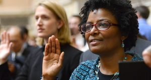 Incoming state Sen. Mary Washington, shown during her swearing-in as a House delegate, says she is strongly opposed to any plan for Johns Hopkins to have its own police department. (File Photo)