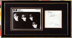"""With the Beatles"" cover along with a sheet signed by all four Beatles. (Submitted photo)"