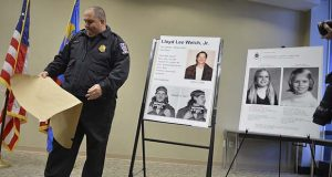 """FILE - In this Feb. 11, 2014 file photo, Montgomery County Police Officer Robert Ladan uncovers photos of Lloyd Lee Welch Jr. during a news conference in Gaithersburg, Md. A published report says Welch, accused in the 1975 murders of two young sisters who disappeared from a Maryland shopping mall, plans to plead guilty to a crime that's haunted the region for more than four decades. Welch was scheduled to go on trial Tuesday, Sept. 12, 2017, in the killings of 12-year-old Sheila Lyon and 10-year-old Katherine Lyon. Online court records indicate the jury trial has been """"withdrawn"""" and a motion hearing is scheduled instead. (Ricky Carioti /The Washington Post via AP, File)"""