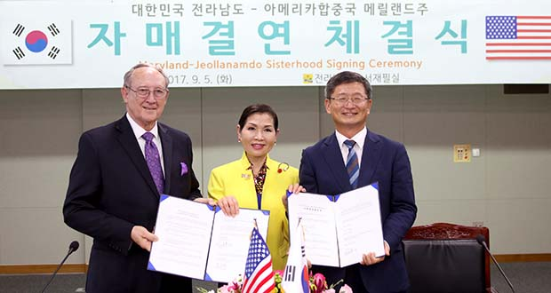 Maryland Secretary of State John Wobensmith; left; First Lady Yumi Hogan; center; and Kim Kab-sub; the acting governor of Jeollanam-do; pose for photos after Wobensmith and Kim signed an agreement making Jeollanam-do and Maryland into sister states. (Governor's Office photo)
